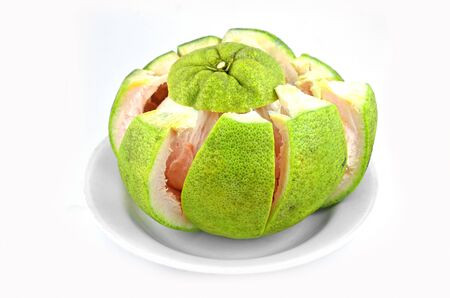 Fresh grapefruit peel green body in pink meat on a white background.