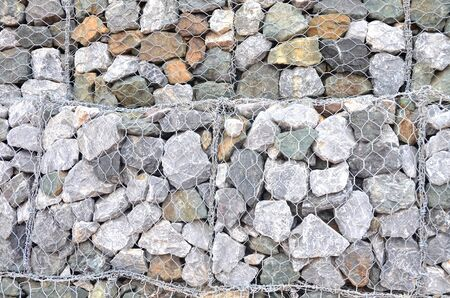 The walls are made of stone, laid together and wire.