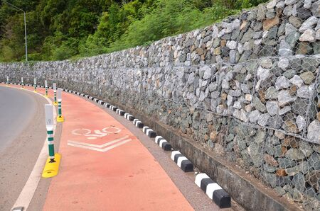 Bicycle lanes stick with the beach and a stone wall along the line.
