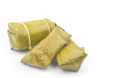 Mush stuffed with banana leaves on a white background.