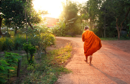 Buddha monk walk in the morning for receive food from Buddhism.