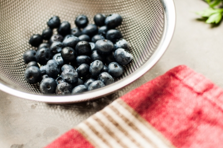 sifter: Blueberries in a sifter Stock Photo