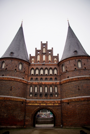 The Holstentor is a late Brick Gothic city gate in Lubeck photo
