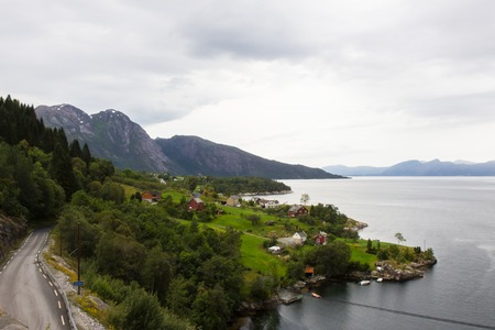 norwegian: Landscape with mountains in Norwegian village in Norwegian fjords
