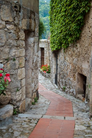 view of a wooden doorway: streets of ancient town of  Eze, south  France Stock Photo
