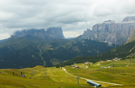 view of Dolomites mountains on a foggy day, South Tyrol, Italy