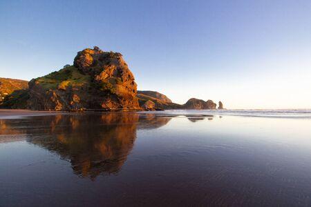 sunset at Piha beach, North island, New Zealand Banco de Imagens