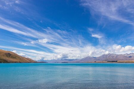 view of Tekapo lake on a sunny day, South island, New Zealand