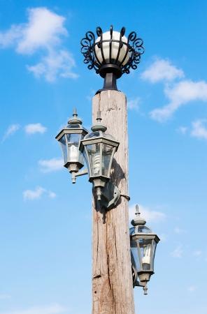 streetlamp: Lamp wood pole and blue sky Stock Photo