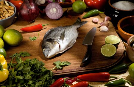 gutted: uncooked sea bream with raw ingredients