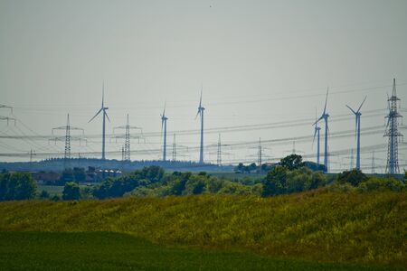 Part of a power line with wind turbines in Bavaria