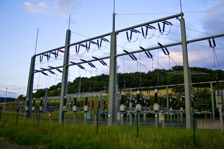 Power transformer in high voltage switchyard in modern electrical substation in Hesse, Germany