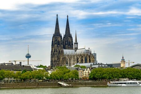 The Cologne Cathedral from the other side of the Rhine with TV Tower in the background in Cologne Germany