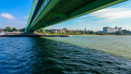 A tanker sails on the Rhine under the Severinsbridge in Cologne
