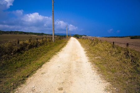 country road and  the sky and clouds Stock Photo - 6650208