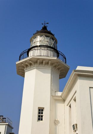 White lighthouse at the harbor  photo