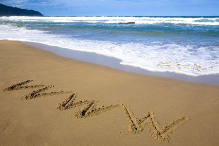 internet symbol draw on beach  photo