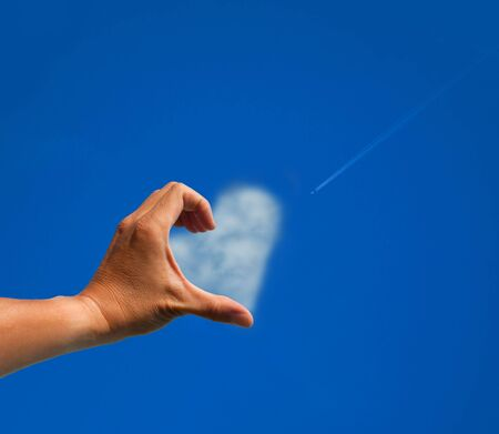 The love symbol by hand and cloud photo