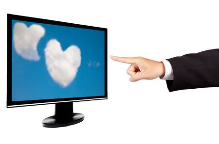 businessman hand and computer monitor with touch screen photo