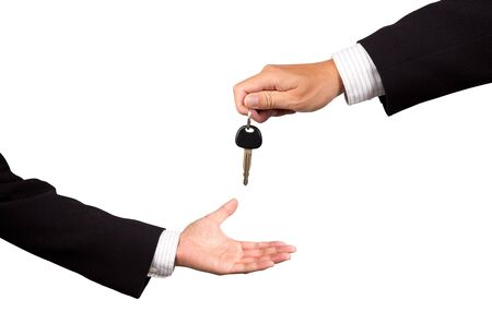 key handover: businessman receiving car key from salesman  Stock Photo