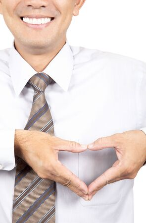smiling businessman with heart made from hands  Stock Photo