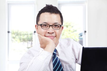 young asian businessman  with computer Stock Photo - 7562578