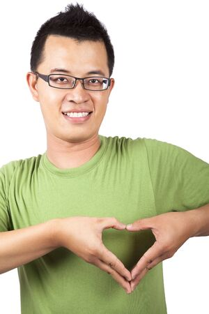 forming: young man with two hand forming a heart shape  Stock Photo