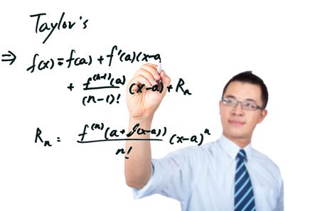 young teacher drawing a Mathematical formula Stock Photo