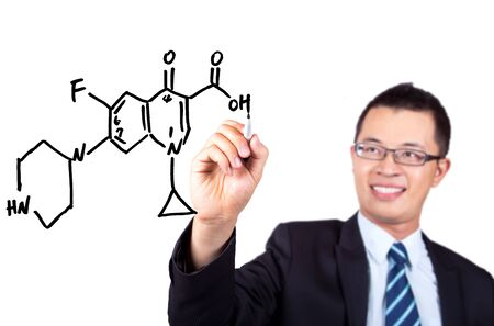 young teacher drawing a Chemical formula graph  Stock Photo - 7562583