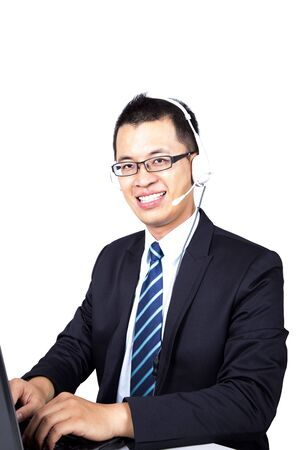 answer phone: happy young businessman working on computer and answer phone call