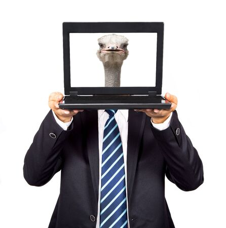 businessman hold the computer with Ostrich head photo