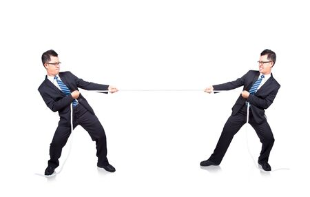 business man playing tug of war with himself photo