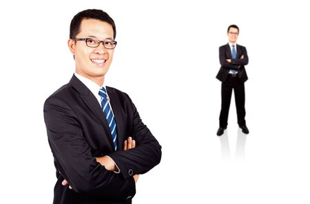 Portrait of a smiling young businessman standing against isolated white background  Stock Photo - 7562602