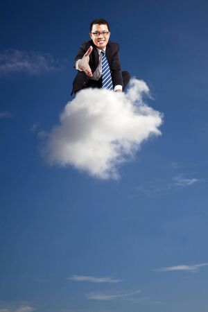 welcome join cloud business .businessman welcoming handshake on the cloud photo