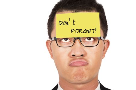 keep: do not forget and keep in mind.young businessman helpless looking the post it