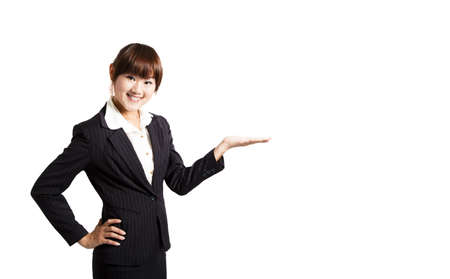 young smiling businesswoman. with her hand outstretched and presenting something Stock Photo - 7704728