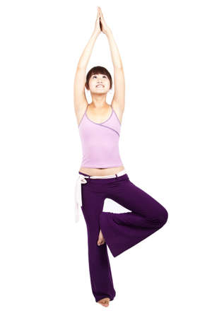 young happy asian girl practicing yoga  Stock Photo - 7704727