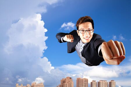 businessman fly in sky over the city Stock Photo - 7704735