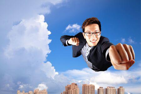 hard work ahead: businessman fly in sky over the city