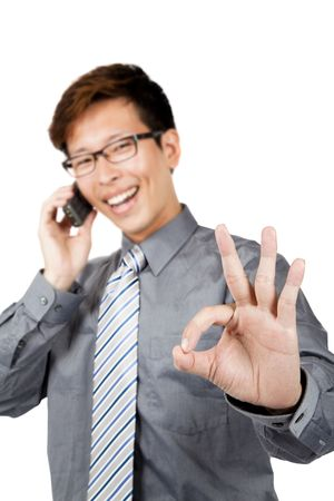 smiling and successful businessman  calling on phone with ok sign  Stock Photo - 7795310