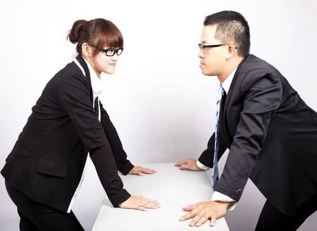 businessman and woman war in office photo