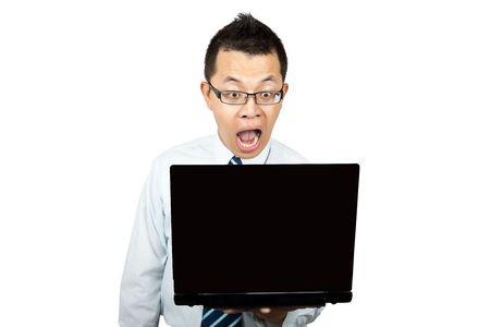 Surprised businessman watching screen of laptop photo