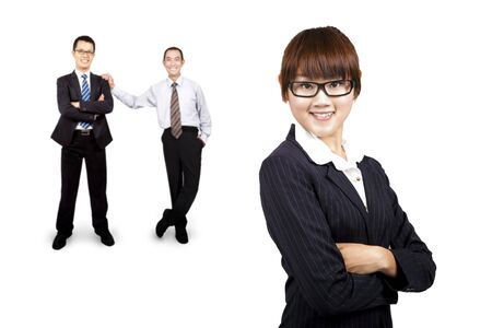 friendly competition: young smiling businesswoman and business team
