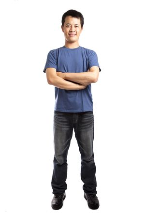 hands in pockets: Full length portrait of a stylish young man standing isolated on white background