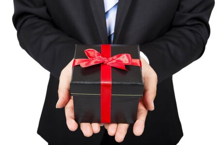 bonus: businessman holding a gift package in hand