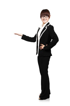 introductions: full body young smiling businesswoman. with her hand outstretched and presenting something