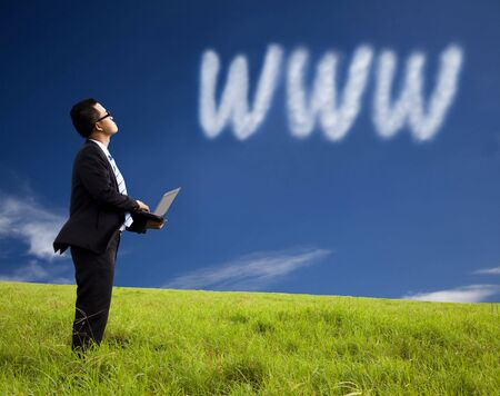 explore: Internet cloud computing concept. businessman using laptop and watching internet cloud Stock Photo