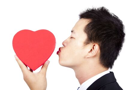 young man kissing red gift box of love Stock Photo - 7968203