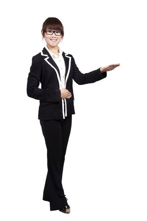 introductions: full body young smiling businesswoman. with her hand outstretched and Introduction something