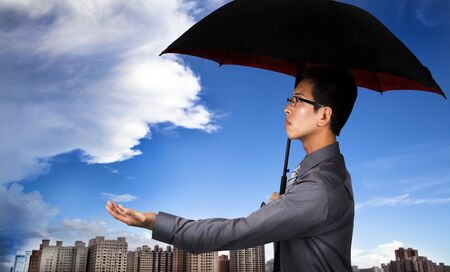 The insurance agent with umbrella and Weather Observation Stock Photo - 7968208